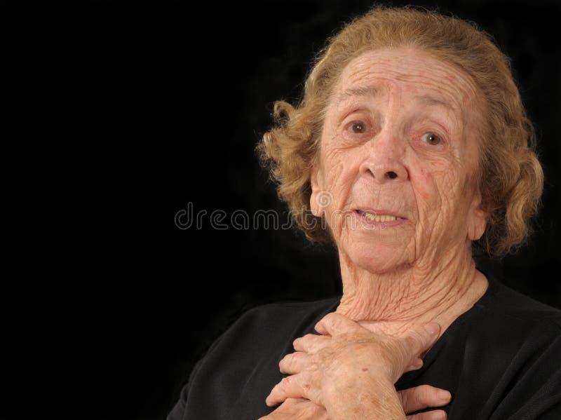 Abuela en la consternación foto de archivo