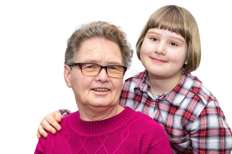 Abuela y nieto junto en el fondo blanco imagenes de archivo