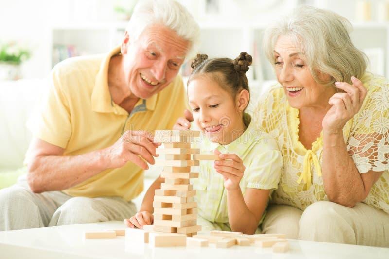 Abuelos y nieta con los bloques de madera fotografía de archivo libre de regalías