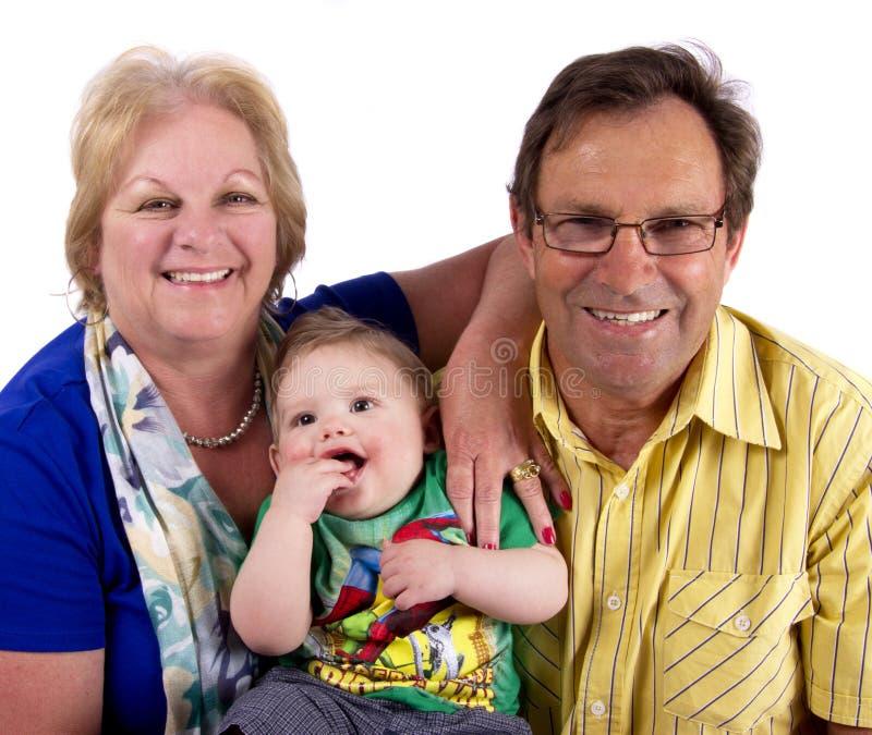 Abuelos y su nieto fotografía de archivo libre de regalías