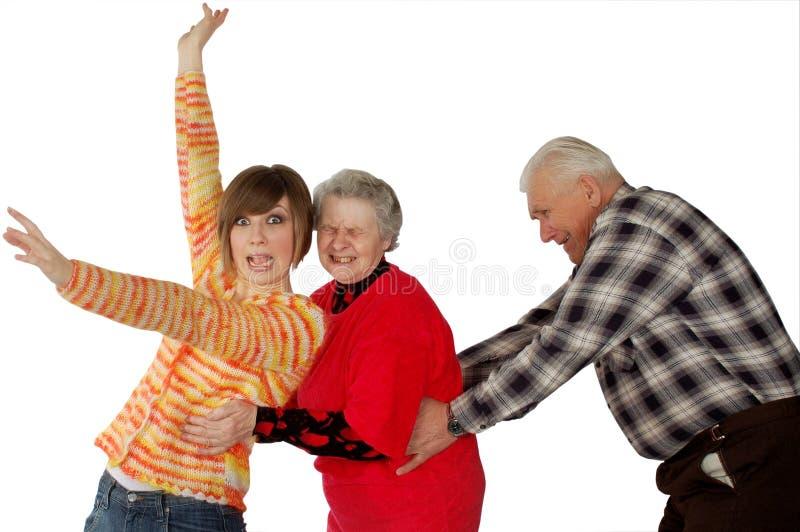 Abuelos y tonto felices del juego de la nieta fotografía de archivo libre de regalías