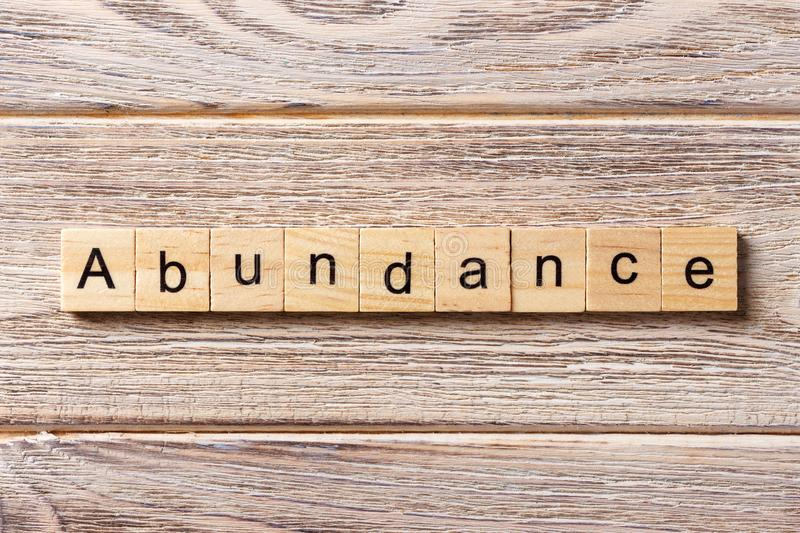 Abundance word written on wood block. abundance text on table, concept.  stock image