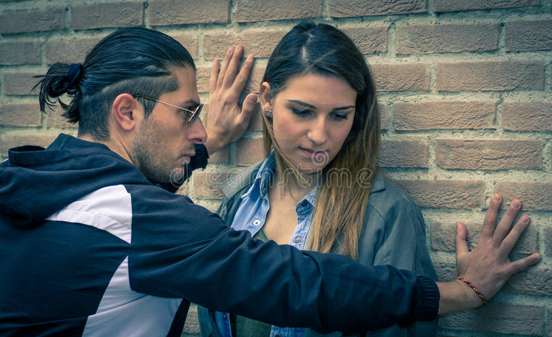 Abuse. Man wants to abuse his girlfriend royalty free stock photos