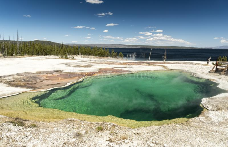 Abyss Pool West Thumb Geyser Basin Yellowstone National Park. This small, colorful geyser in Yellowstone National Park also features scenic lake views stock photos