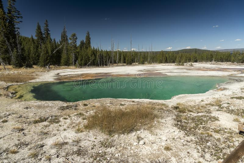 Abyss Pool West Thumb Geyser Basin Yellowstone National Park. This small, colorful geyser in Yellowstone National Park also features scenic lake views royalty free stock image