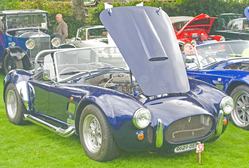 AC Cobra kit car. An image of an AC Cobra kit car with bonnet raised to show off the engine displayed at Fortrose Classic car Rally on 25th August 2010 stock photo