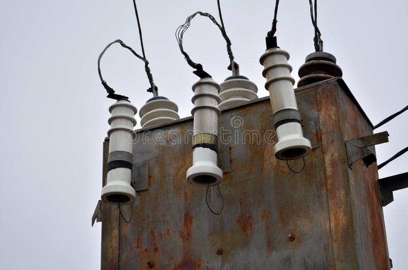 AC high-voltage power transformer. Electrical energy transfer to end users through distribution transformer on concrete pole stock photography