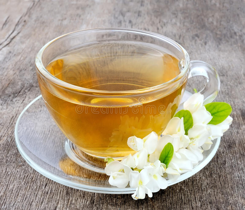Acacia tea. Closeup on wooden tables royalty free stock photography