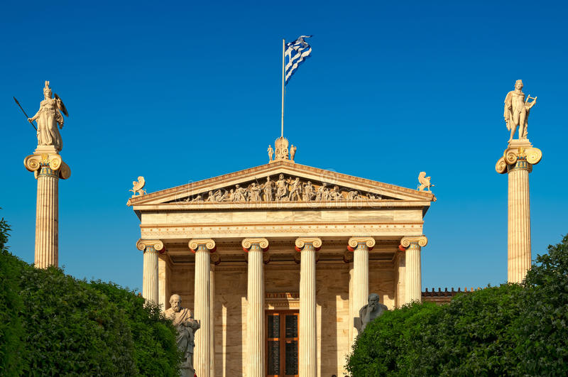 Academy of Athens. And statues of Platon (left), Socrates (right) On the columns are goddess Athena and Apollo royalty free stock photography