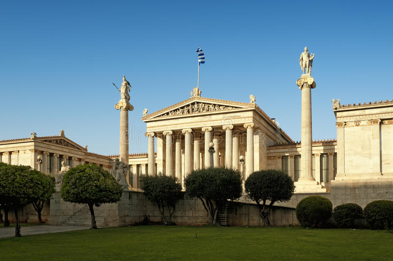 Academy of Athens. And statues of Platon (left), Socrates (right) On the columns are goddess Athena and Apollo stock images