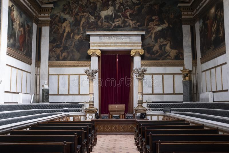 Academy of Athens for the advancement of the Sciences. Inside the Academy of Athens showing the wooden benches and padded rows on the sides royalty free stock photos