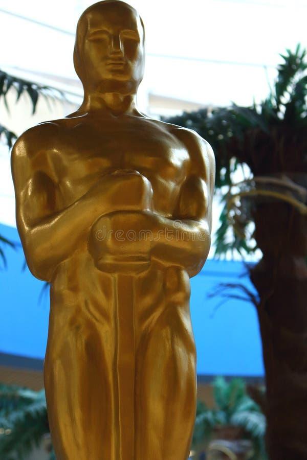Academy award Oscar statue. Cinema nomination and trophy. Golden Oscar. stock images