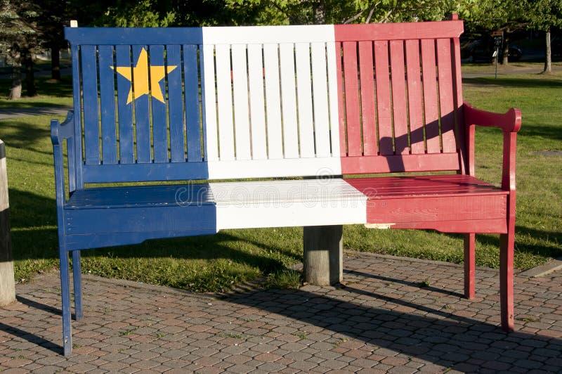 Acadian flaga na ławce Nowy Brunswick - Edmundston - fotografia royalty free