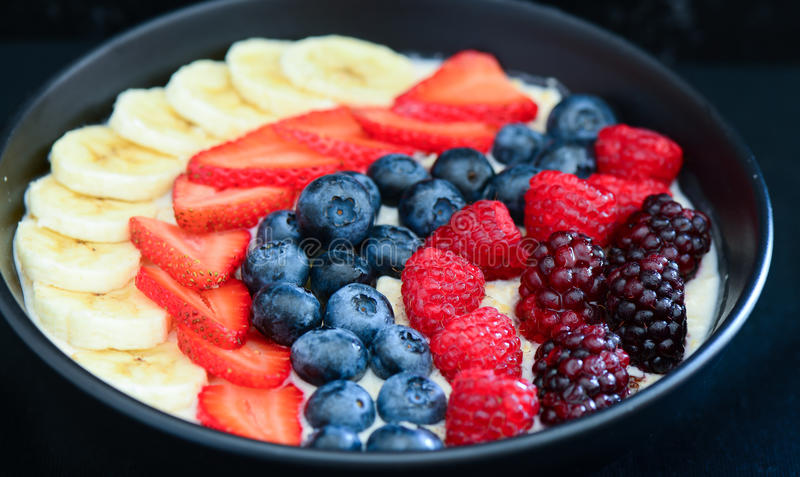 Acai fruit bowl. Healthy breakfast acai bowl with cereal and berries royalty free stock image