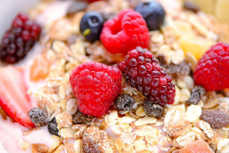 Acai fruit bowl. Healthy breakfast acai bowl with muesli cereal and berries royalty free stock photography