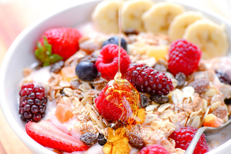 Acai fruit bowl with muesli cereal. Healthy breakfast acai bowl with muesli cereal,nuts and berries stock photos