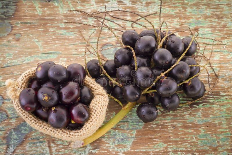 Acai fruit and powder Euterpe oleracea stock photo