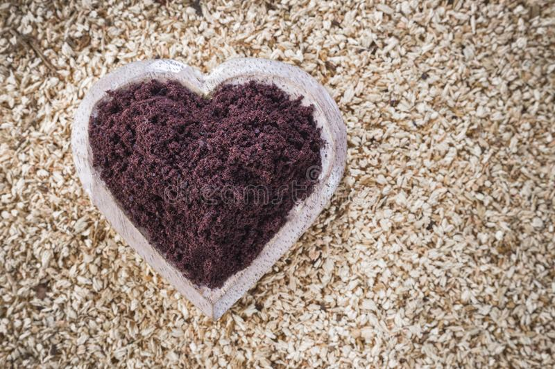 Acai powder in bowl on wooden stock images