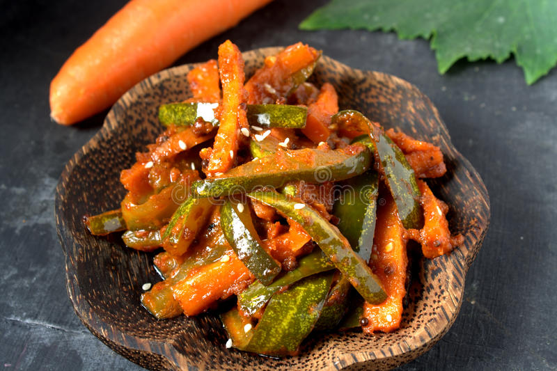 Acar - Malaysian Food. Acar is a Malay and Indonesian cuisine. Chunks of cucumber, carrot, shallot, bird's eye chili, spices and marinated with sugar and vinegar royalty free stock photo