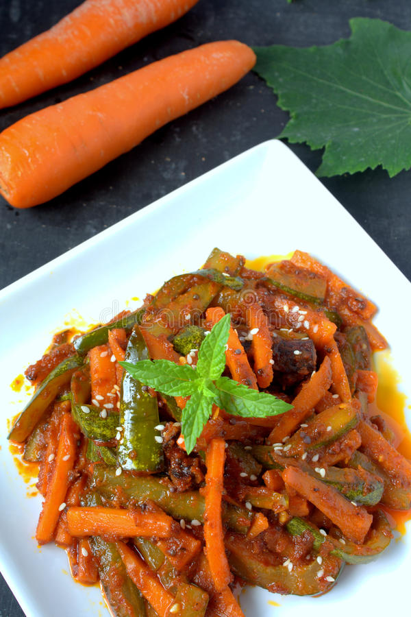Acar - Malaysian Food. Acar is a Malay and Indonesian cuisine. Chunks of cucumber, carrot, shallot, bird's eye chili, spices and marinated with sugar and vinegar royalty free stock photos