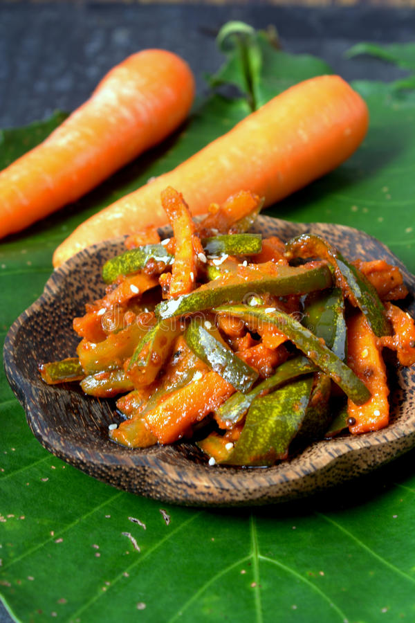 Acar - Malaysian Food. Acar is a Malay and Indonesian cuisine. Chunks of cucumber, carrot, shallot, bird's eye chili, spices and marinated with sugar and vinegar stock image