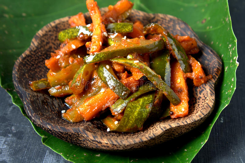 Acar - Malaysian Food. Acar is a Malay and Indonesian cuisine. Chunks of cucumber, carrot, shallot, bird's eye chili, spices and marinated with sugar and vinegar stock photo