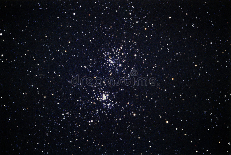 Acca Chi Persei Star Cluster. Here an other shot through a 700mm lens with my old Nikon film camera. 20 minutes of exposition for this open star cluster, in a stock photo