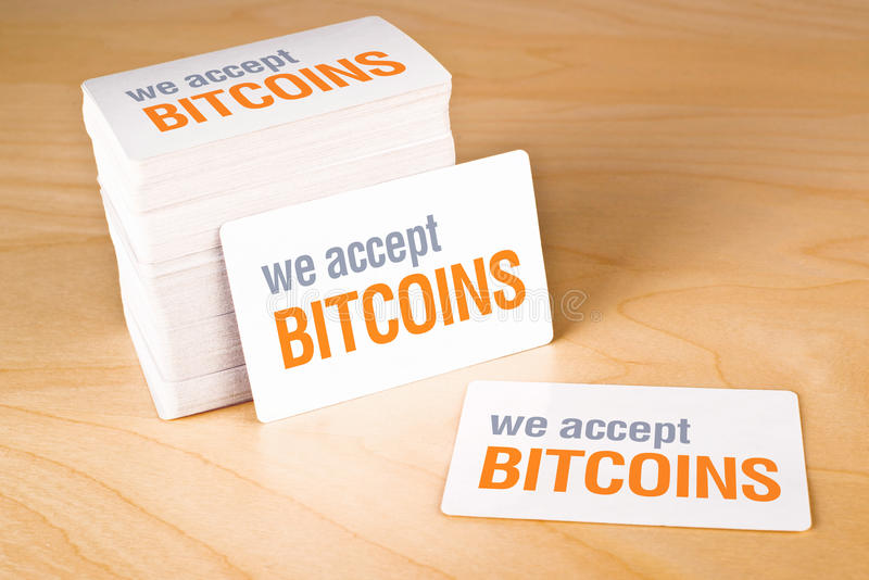 We accept bitcoins. Business cards with rounded corners. Stack of blank horizontal business cards propped up another royalty free stock photos