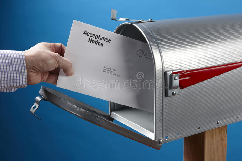 Acceptance Notice. Man takes Acceptance Notice out of an open mailbox royalty free stock photos