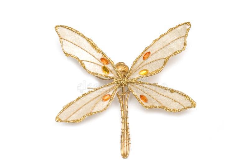 Accesorio de oro en libélula de la forma fotografía de archivo libre de regalías