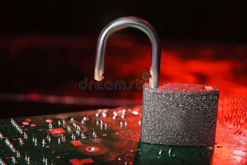 Hacked system. Open lock on a red background. Access background business code communication computer controlled data digital finance general identity royalty free stock photography