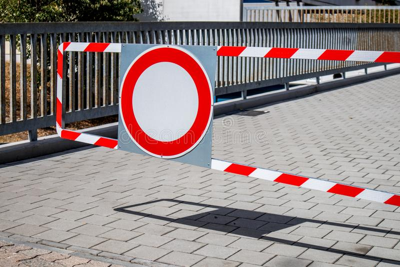 Access denied. Warning sign. Access denied. Warning sign and barriers plant in front of a parking place royalty free stock photo