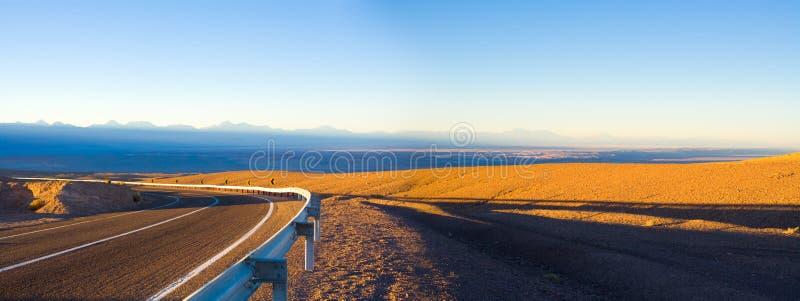 Access road and panoramic view of Atacama Salt Lake Salar de Atacama and San Pedro de Atacama royalty free stock images