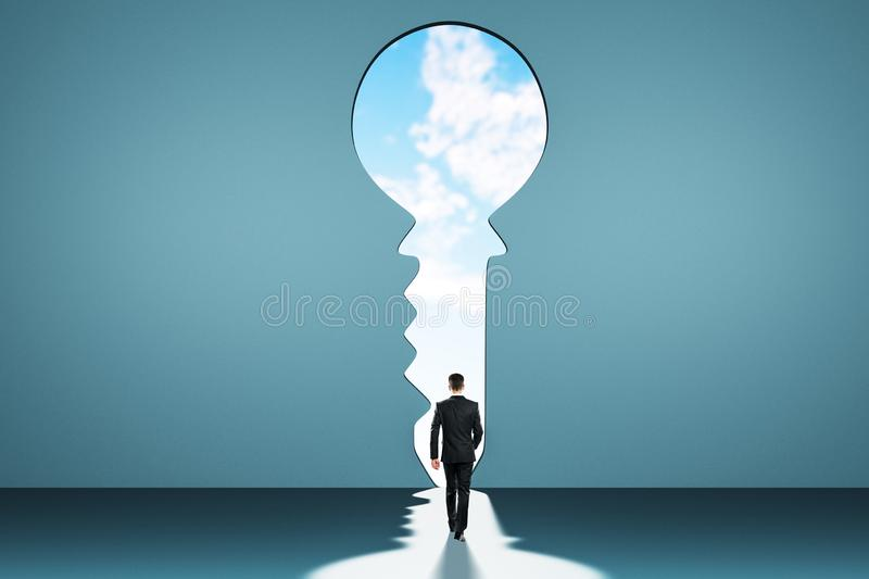 Access and success concept. Back view of young businessman in abstract blue interior with keyhole window and sky view. Access and success concept stock illustration