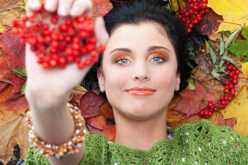 Access to autumn. Girl showing her access to autumn royalty free stock photo