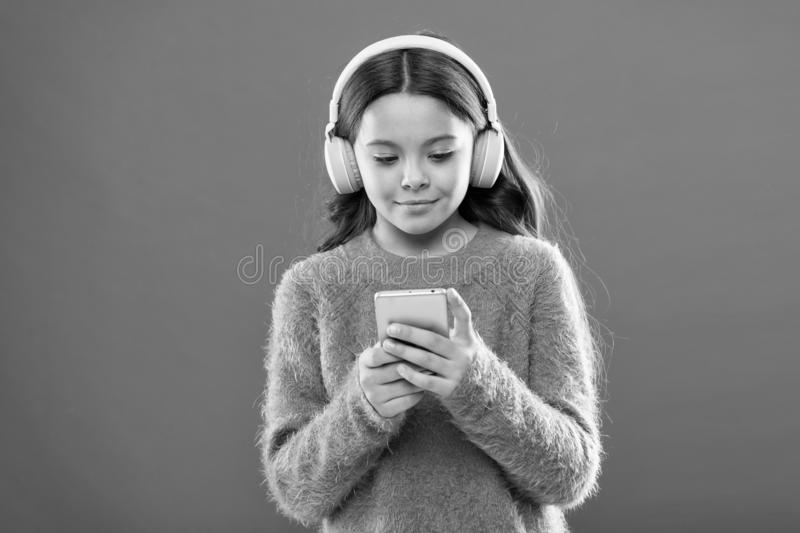 Access to millions of songs. Enjoy music concept. Best music apps that deserve a listen. Girl child listen music modern royalty free stock images