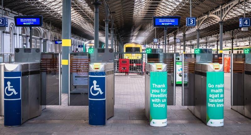 Access turnstile at the platform at Heuston station in Dublin, Ireland. Dublin, Ireland - February 13, 2019: Access turnstile at the platform at Heuston station stock images
