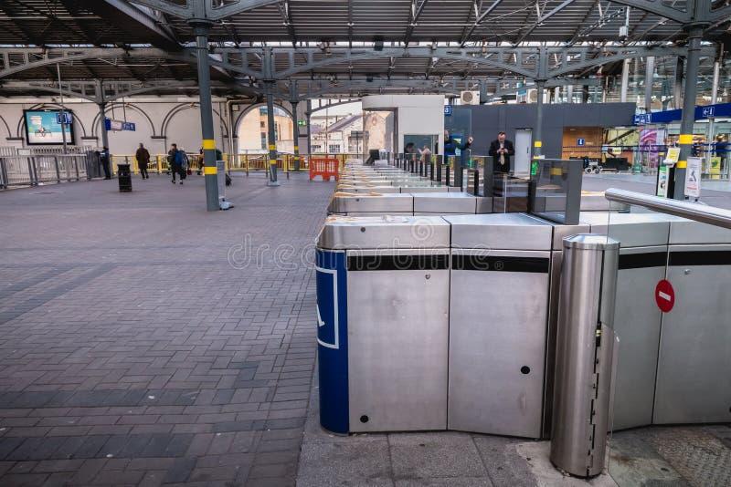 Access turnstile at the platform at Heuston station in Dublin, Ireland. Dublin, Ireland - February 13, 2019: Access turnstile at the platform at Heuston station royalty free stock photo