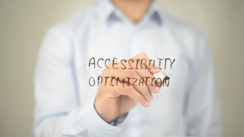 Accessibility Optimization, Man writing on transparent screen. High quality royalty free stock photos
