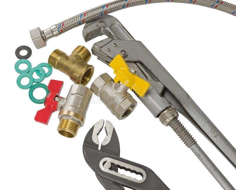 Accessoires et outils de tuyauterie photographie stock