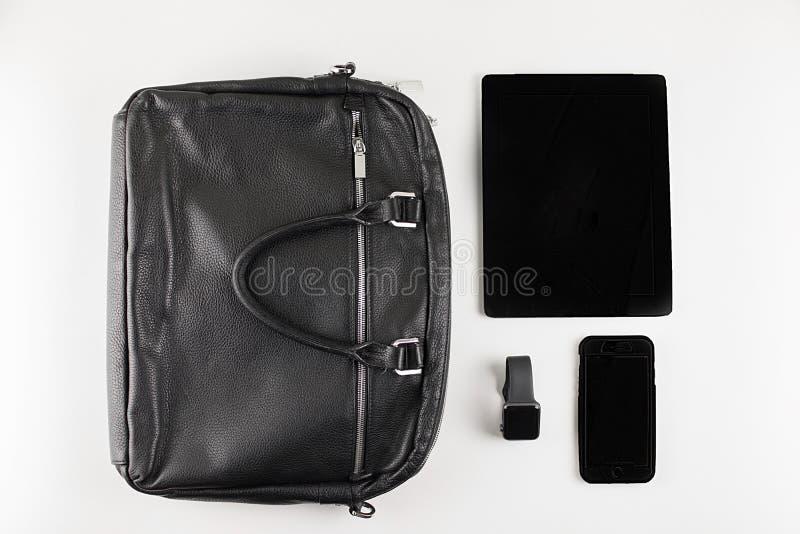Accessoires pour le travail et les affaires sur un fond blanc images stock