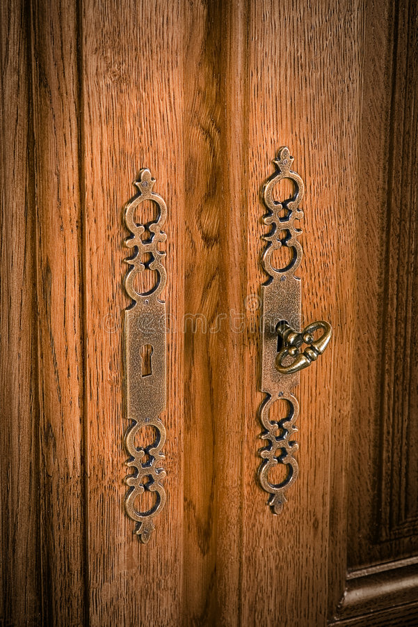 Accessories. Furniture key at doors of a case stock photo