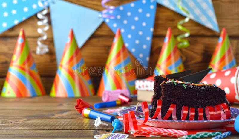 Accessories for birthday parties. On a brown background stock photography
