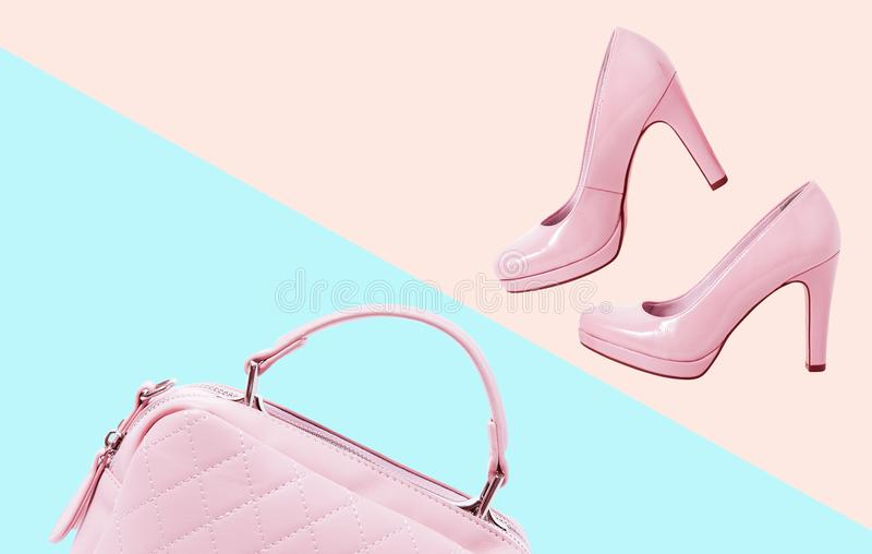 Accessories clothes fashion set. Stylish woman accessories pink handbag clutch and shoes on colorful background. Summer stock photography