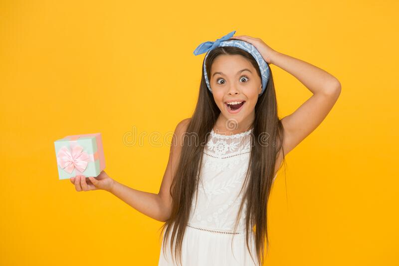 Accessories and cosmetics. Summer season. Buy gift. Online shopping. Perfect gift concept. Celebrate holidays. Cute. Small kid adorable dress. Girl long hair royalty free stock image