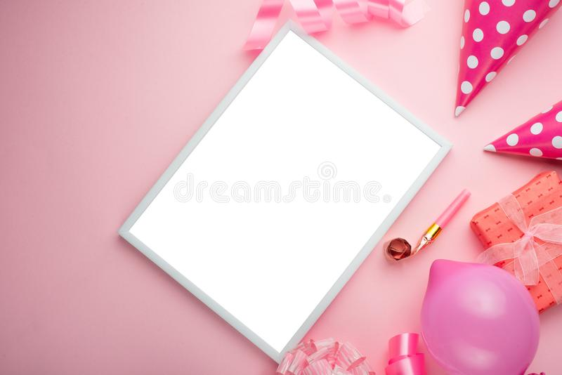 Accessories for girls on a pink background. Invitation, birthday, girlhood party, baby shower concept, celebration. With frame for royalty free stock photography