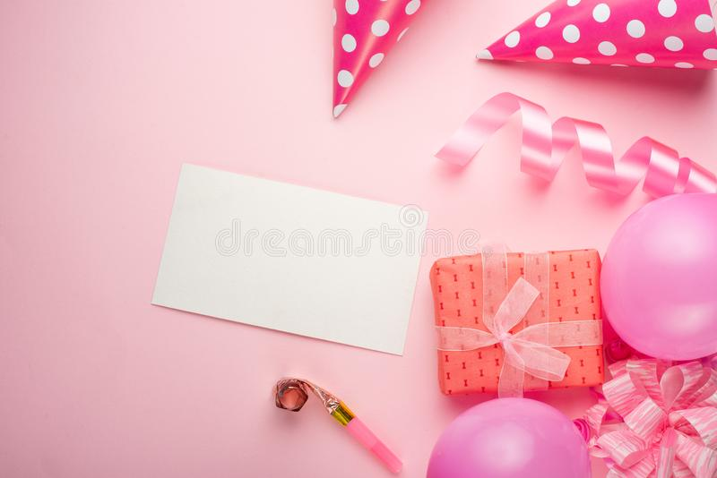 Accessories for girls on a pink background. Invitation, birthday, girlhood party, baby shower concept, celebration. With frame for. Design stock photo
