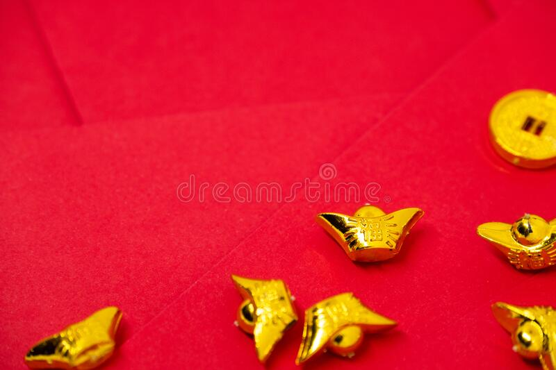 Accessories lump of gold with words for lucky, good fortune, and happiness decoration on red background with copy space for text , royalty free stock photos