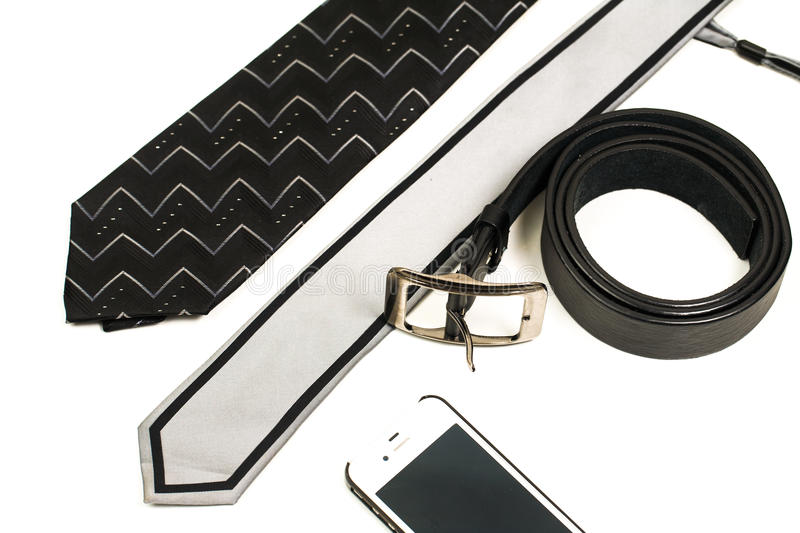Accessories for men in the office isolated on white. Cellphone, necktie royalty free stock photos
