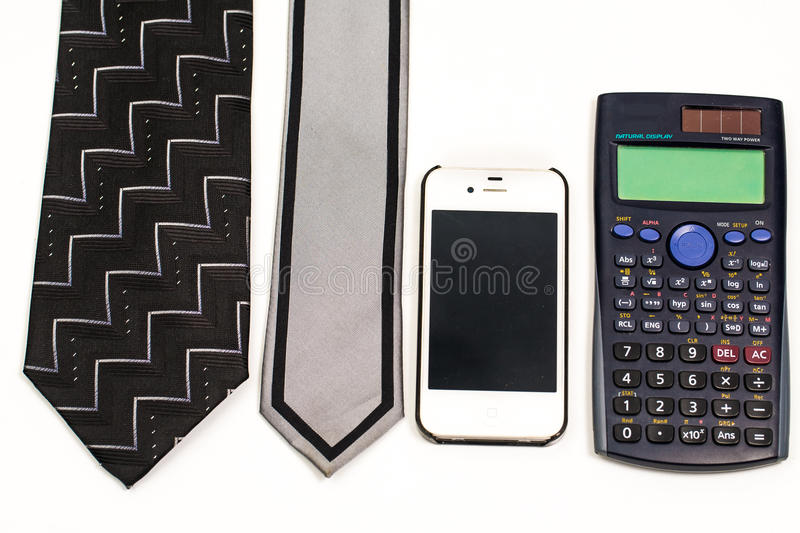 Accessories for men in the office isolated on white, cellphone,. Necktie and calculator stock photo